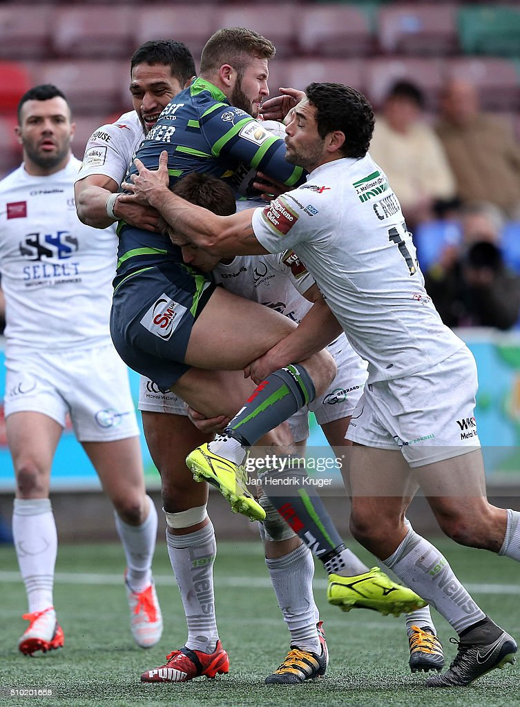 Zak Hardaker of Leeds Rhinos is upended by <a gi-track='captionPersonalityLinkClicked' href=/galleries/search?phrase=Kevin+Brown+-+Rugbyspieler&family=editorial&specificpeople=11919095 ng-click='$event.stopPropagation()'>Kevin Brown</a> of Widnes Vikings during the First Utility Super League match between Widnes Vikings and Leeds Rhinos at Select Security Stadium on February 14, 2016 in Widnes, England.