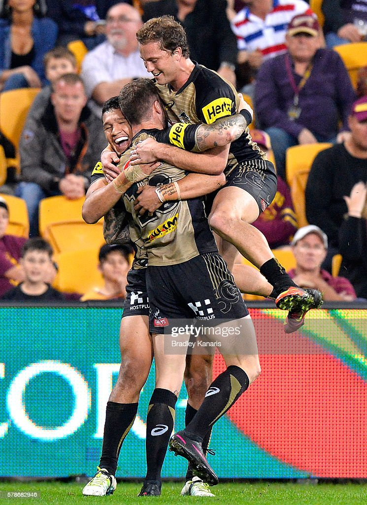Zak Hardaker of the Panthers celebrates scoring a try with team mates during the round 20 NRL match between the Brisbane Broncos and the Penrith Panthers at Suncorp Stadium on July 22, 2016 in Brisbane, Australia.