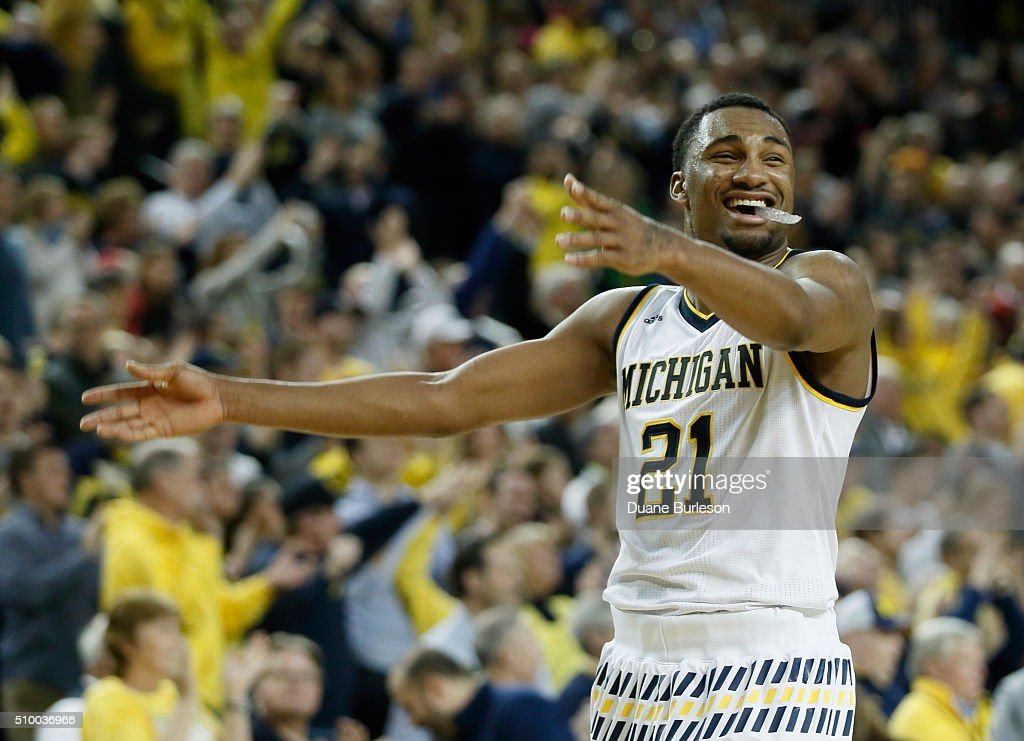 Zak Irvin #21 of the Michigan Wolverines celebrates after Michigan took the lead over Purdue late in the second half at Crisler Arena on February 13, 2016 in Ann Arbor, Michigan. Irvin scored 22 points in a 61-56 win over Purdue.