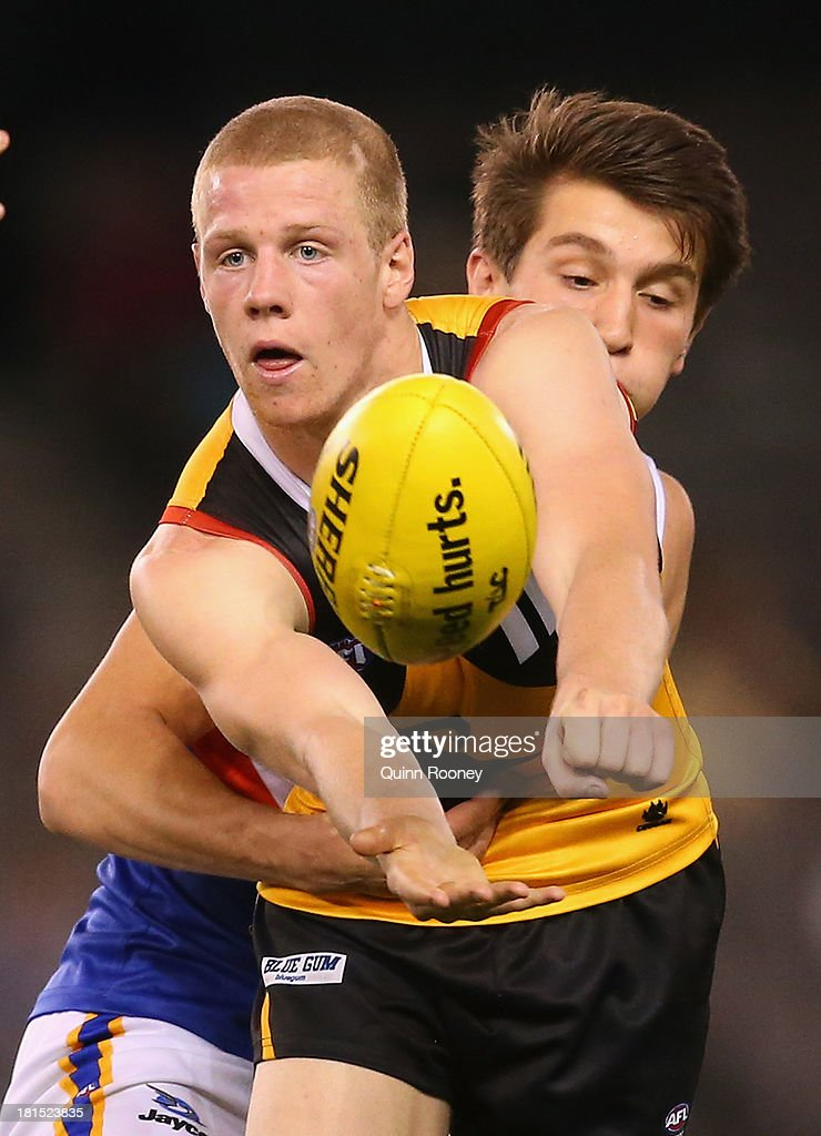 <a gi-track='captionPersonalityLinkClicked' href=/galleries/search?phrase=Zak+Jones&family=editorial&specificpeople=4185625 ng-click='$event.stopPropagation()'>Zak Jones</a> of the Stingrays handballs whilst being tackled during the TAC Cup final match between Eastern Ranges and the Dandenong Southern Stingrays at Etihad Stadium on September 22, 2013 in Melbourne, Australia.