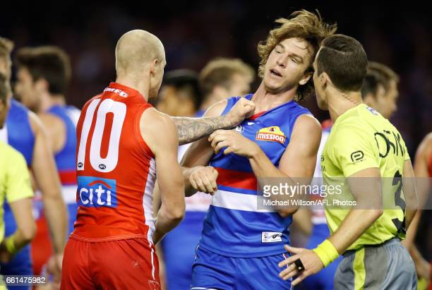 Zak Jones of the Swans and Liam Picken of the Bulldogs clash during the 2017 AFL round 02 match between the Western Bulldogs and the Sydney Swans at...