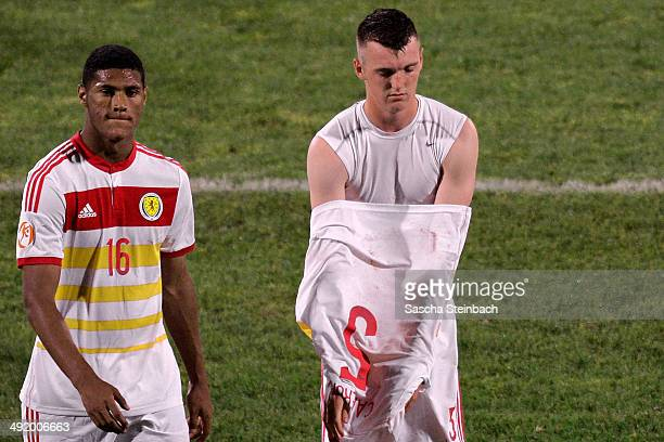 Zak Jules and Kyle Cameron of Scotland react after losing the UEFA Under17 European Championship 2014 semi final match against Netherlands at Ta'...