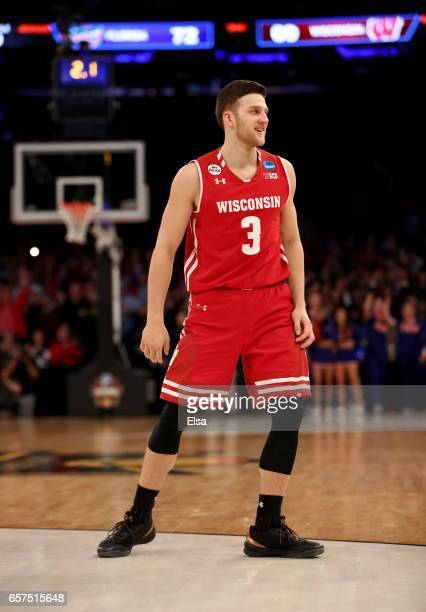 Zak Showalter of the Wisconsin Badgers celebrates after making a three point basket with 25 seconds left in the second half to tie the game 72 to 72...