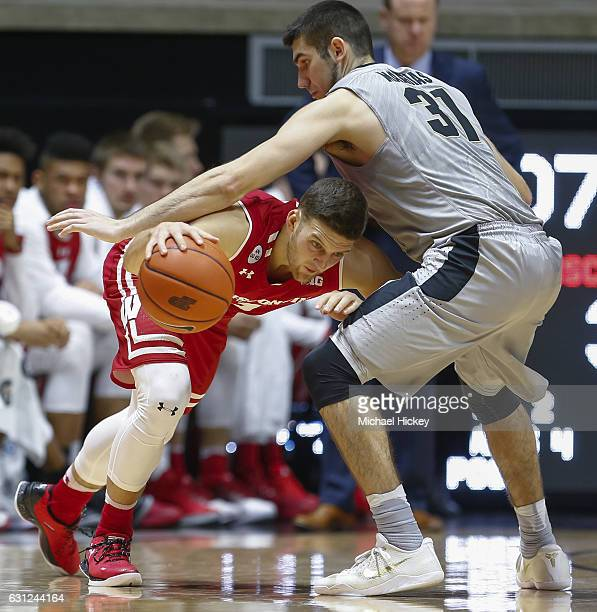 Zak Showalter of the Wisconsin Badgers dribbles the ball against Dakota Mathias of the Purdue Boilermakers at Mackey Arena on January 8 2017 in West...