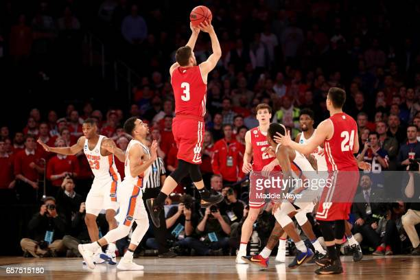 Zak Showalter of the Wisconsin Badgers makes a three point basket with 25 seconds left in the second half to tie the game 72 to 72 against the...