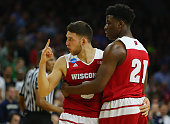 Zak Showalter of the Wisconsin Badgers reacts with teammate Khalil Iverson in the second half against the Notre Dame Fighting Irish during the 2016...