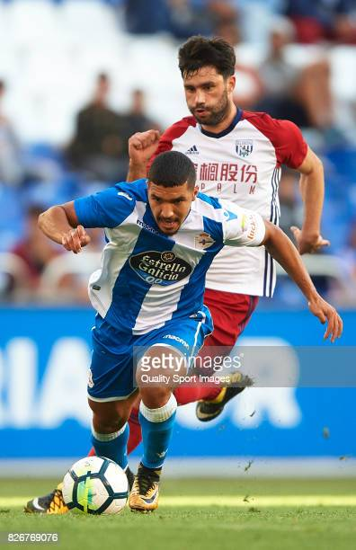 Zakaria Bakkali of Deportivo de La Coruna beats Claudio Yacob of West Bromwich Albion during the Pre Season Friendly match between Deportivo de La...