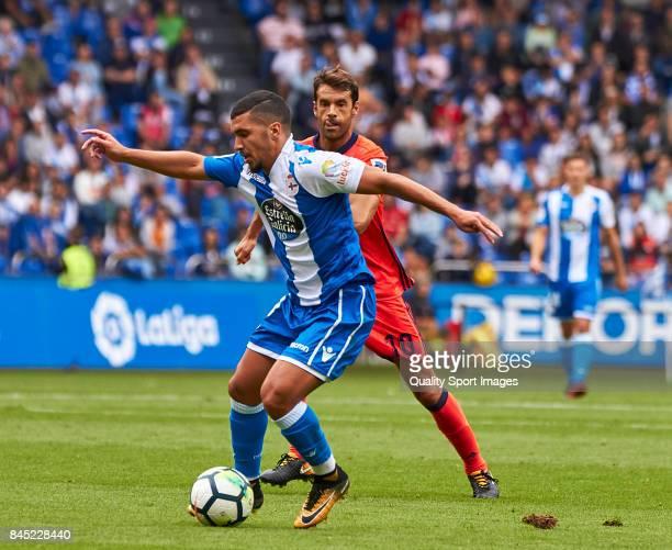 Zakaria Bakkali of Deportivo de La Coruna is challenged by Xavi Prieto of Real Sociedad during the La Liga match between Deportivo La Coruna and Real...
