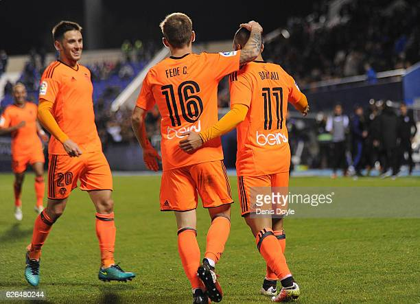 Zakaria Bakkali of Valencia CF celebrates with Fede Cartabia after scoring his team's 3rd goal during the Copa del Rey Round of 32 match between CD...