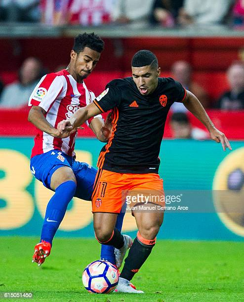 Zakaria Bakkali of Valencia CF duels for the ball with Akram Afif of Real Sporting de Gijon during the La Liga match between Real Sporting de Gijon...