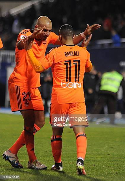 Zakaria Bakkali of Valencia CF is congratulated by Aymen Abdennour after scoring his team's 3rd goal during the Copa del Rey Round of 32 match...