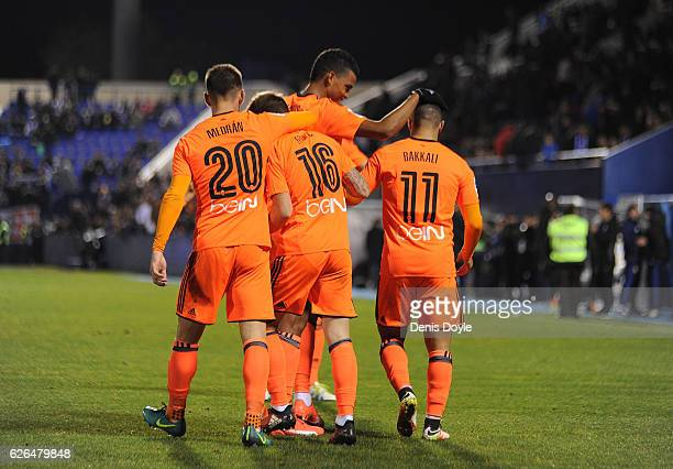 Zakaria Bakkali of Valencia CF is congratulated by teammates after scoring his team's 3rd goal during the Copa del Rey Round of 32 match between CD...
