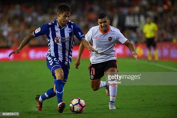 Zakaria Bakkali of Valencia CF vies Kiko Femenia of Deportivo Alaves during the La Liga match between Valencia CF vs Deportivo Alaves at Mestalla...