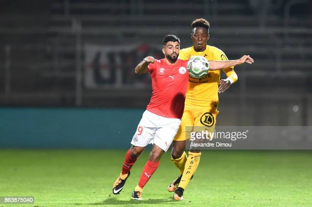 Zakaria Diallo of Brest and Umut Bozok of Nimes during the Ligue 2 match between Nimes Olympique and Brest on October 20 2017 in Nimes France