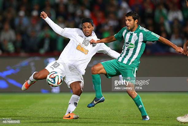 Zakaria El Hachimi of Raja Casablanca tackles Ronaldinho of Atletico Mineiro during the FIFA Club World Cup Semi Final match between Raja Casablanca...