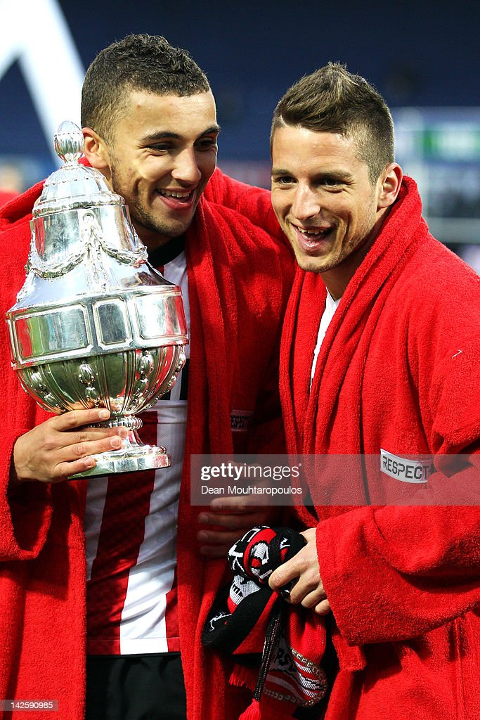 Zakaria Labyad and Dries Mertens of PSV lead celebrations with the trophy after victory in the Dutch Cup Final between PSV Eindhoven and SC Heracles...