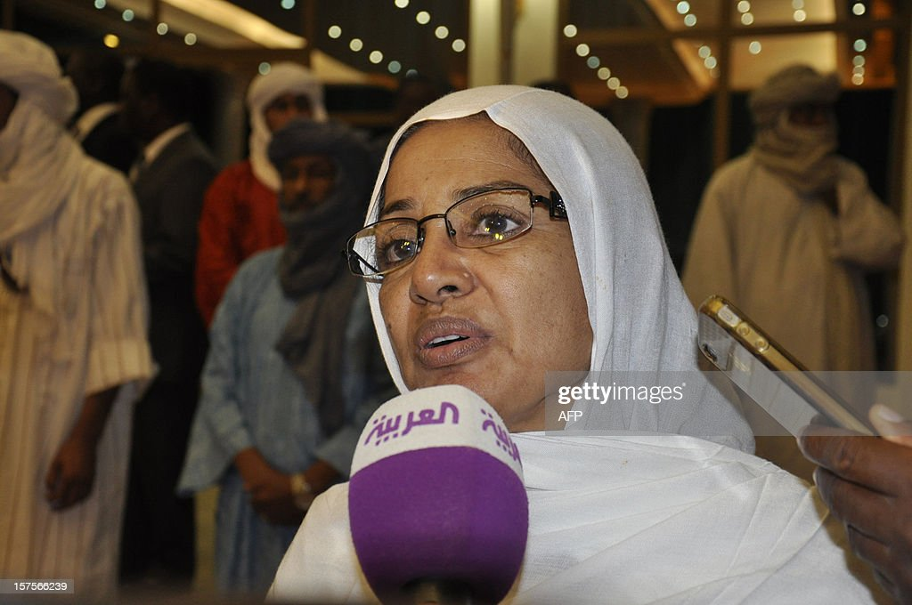Zakiatou Ouallet Halatine, spokesperson for the ARVRA, an organization dedicated to the refugees and victims of repression in the Azawad region of northern Mali, speaks to journalists at the end of a mediation meeting with members of the Malian government, the islamist Ansar Dine group, and the Azawad National Liberation Movement (MNLA) Tuareg rebellion, hosted by the Burkina Faso President, in Ouagadougou, on December 4, 2012. Delegations from the Malian government and two rebel groups from the country's vast north held their first talks Tuesday to seek an end to the crisis that has split the west African the country in two. Burkina Faso President Blaise Compaore, west Africa's top mediator for the crisis, hosted the meeting in Ouagadougou, and brought together a Malian government delegation with representatives of Ansar Dine (Defenders of the Faith), one of the Al-Qaeda-linked Islamist groups occupying the north, and the Azawad National Liberation Movement (MNLA), which is fighting for an independent homeland for the Tuareg people.