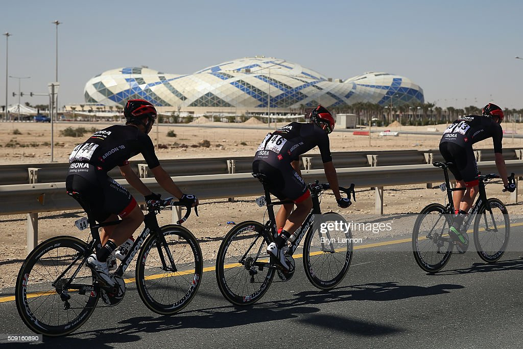 Zakkari Dempster of Australia and Bora-Argon 18 leads riders past the Lusail Sports Arena during stage two of the 2016 Tour of Qatar from Qatar University to Qatar Univeristy on February 9, 2016 in Doha, Qatar. The stage also serves as a test event for the World Road Race Championships which will be held in Doha in October.