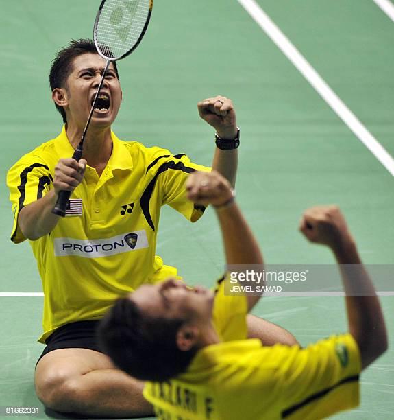 Zakry Abdul Latif and Fairuzizuan Mohammd Tazari of Malaysia celebrate defeating Tony Gunawan of the US and Candra Wijaya of Indonesia during their...