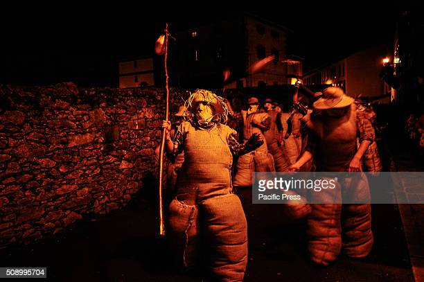 Zaku zaharrak parade through the streets of LesakaNavarra where participants clad in their sacks made of straw and paste the public with their...