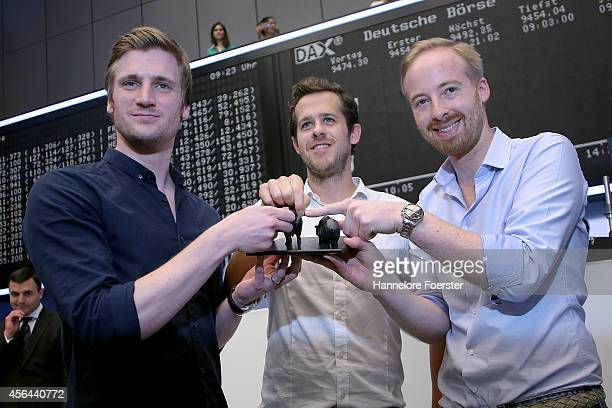 Zalando executives David Schneider Robert Gentz and Rubin Ritter celebrate the launch of the company's Initial Public Offering of shares on the...