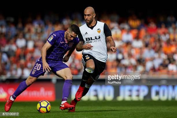 Zaldua of CD Leganes competes for the ball with Simone Zaza of Valencia CF during the La Liga match between Valencia CF and CD Leganes at Mestalla...