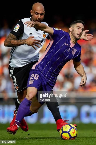 Zaldua of CD Leganes tackled by Simone Zaza of Valencia CF during the La Liga match between Valencia CF and CD Leganes at Mestalla Stadium on...