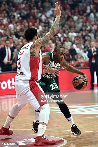 Zalgiris Kaunas' US forward James Anderson vies with Red Star Belgrade's US guard Marcus Williams during the Euroleague Top 16 group E basketball...