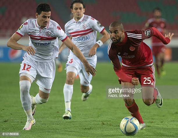 Zamalek Sporting Club's Ahmed Tawfik Mohamed Hassan vies for the ball with Wydad Athletic Club's Ismael elHaddad Fall during the CAF Champions League...