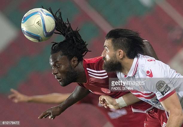 Zamalek Sporting Club's Hazem Mohammed Abdehamid Emam vies for the ball against Wydad Athletic Club's Serigne mourtada Fall during the CAF Champions...