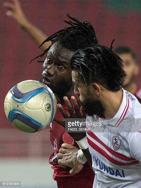 Zamalek Sporting Club's Hazem Mohammed Abdehamid Emam vies with the Wydad Athletic Club's Serigne mourtada Fall during the CAF Champions League...