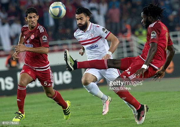 Zamalek Sporting Club's Hazem Mohammed Abdehamid Emam vies with Wydad Athletic Club's Amine Atouchi during the CAF Champions League semifinal between...