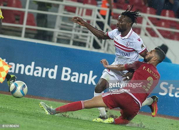 Zamalek Sporting Club's Stanley Ohawuchi vies for the ball against with Wydad Athletic Club's Fahd Aktaou during the CAF Champions League semifinal...