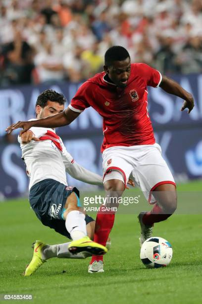 Zamalek's Ahmed Adel tackles AlAhly's Mahmud Hamdi during the Egyptian Super Cup football match between AlAhly and Zamalek on February 10 at Sheikh...