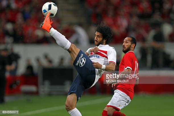 Zamalek's defender Mohamed Nasef clears the ball ahead of AlAhly's midfielder Walid Soliman during the Egyptian Super Cup football match between...