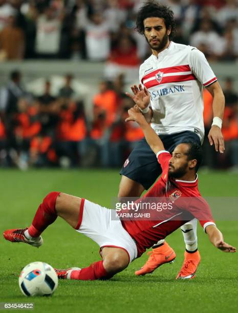 Zamalek's defender Mohamed Nasef is tackled by AlAhly's midfielder Walid Soliman during the Egyptian Super Cup football match between AlAhly and...