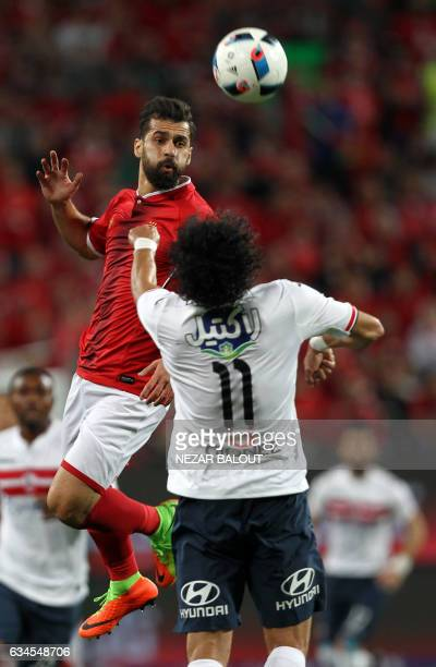 Zamalek's defender Mohamed Nasef vies for the header with AlAhly's midfielder Abdallah Said during the Egyptian Super Cup football match between...