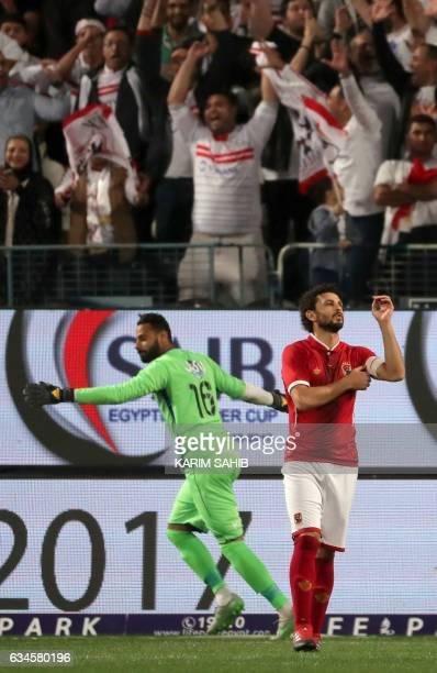 Zamalek's goalkeeper Mahmoud Abdel Rahim celebrates his team's victory as AlAhly's Moamen Zakaria reacts during the Egyptian Super Cup football match...