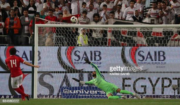 Zamalek's goalkeeper Mahmoud Abdel Rahim watches the penalty of AlAhly's Hossam Ghaly fly over the bar during the Egyptian Super Cup football match...