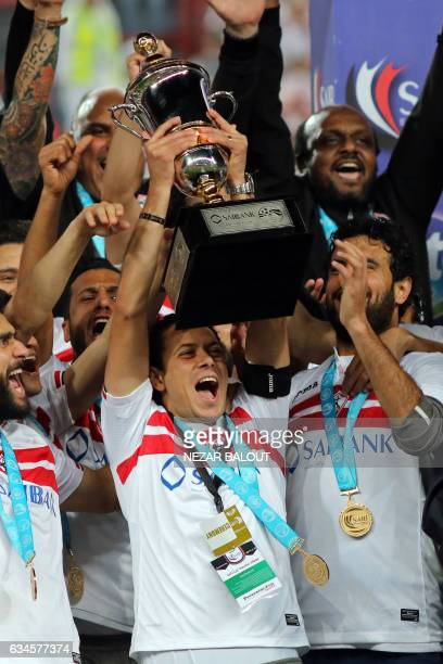 Zamalek's Ibrahim Salah lifts the trophy to celebrate his team's victory in the Egyptian Super Cup football match against AlAhly on February 10 at...