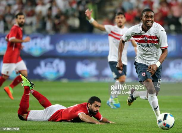 Zamalek's midfielder Maarouf Youssef dribbles past AlAhly's defender Ahmed Fathy during the Egyptian Super Cup football match between AlAhly and...