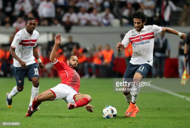 Zamalek's midfielder Mohamed Nasef dribbles past AlAhly's midfielder Walid Soliman during the Egyptian Super Cup football match between AlAhly and...