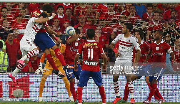 Zamalek's players fight for the ball with AlAhly's defenders in front of AlAhly's goalkeeper during the Egypt super cup football match between AlAhly...