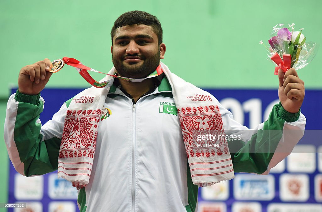 Zaman Avwar of Pakistan displays his gold medal that he won in the men's freestyle wrestling (25kg weight category) at the 12th South Asian Games 2016 in Guwahati on February 8, 2016. AFP PHOTO/ Biju BORO / AFP / BIJU BORO