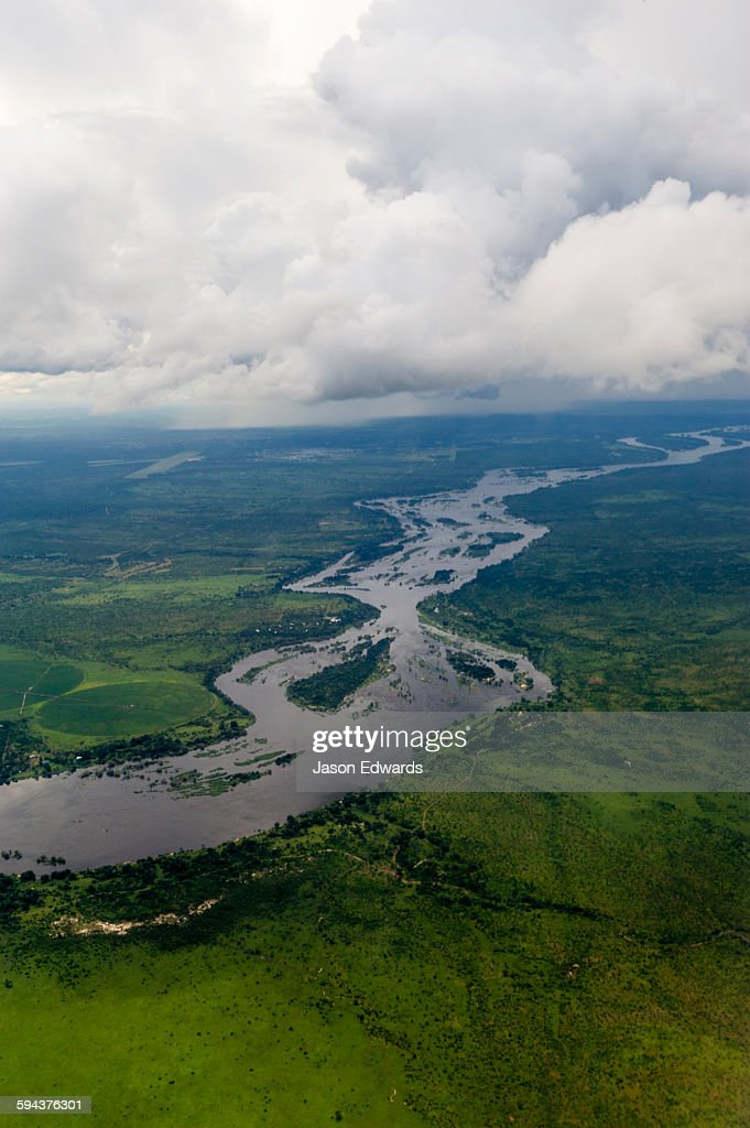 The mighty Zambezi River flowing through a lush savannah plain.