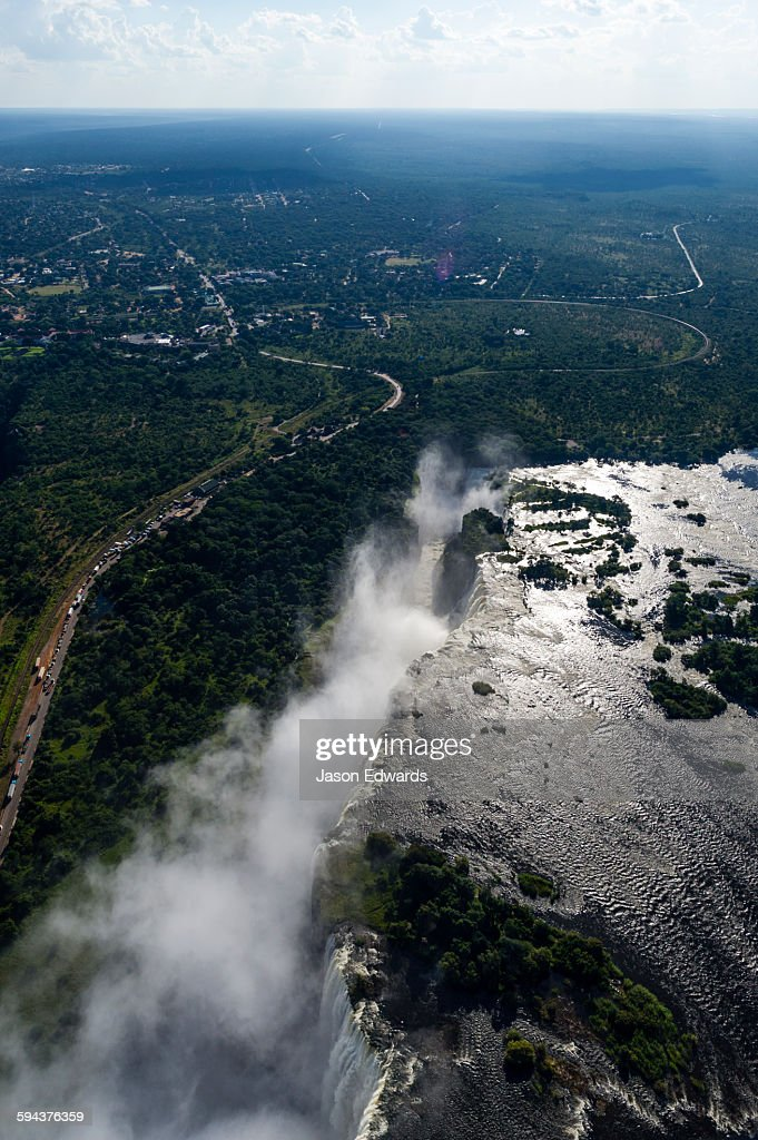 Torrents of water from the Zambezi River cascade over Victoria Falls into the chasm at First Gorge.