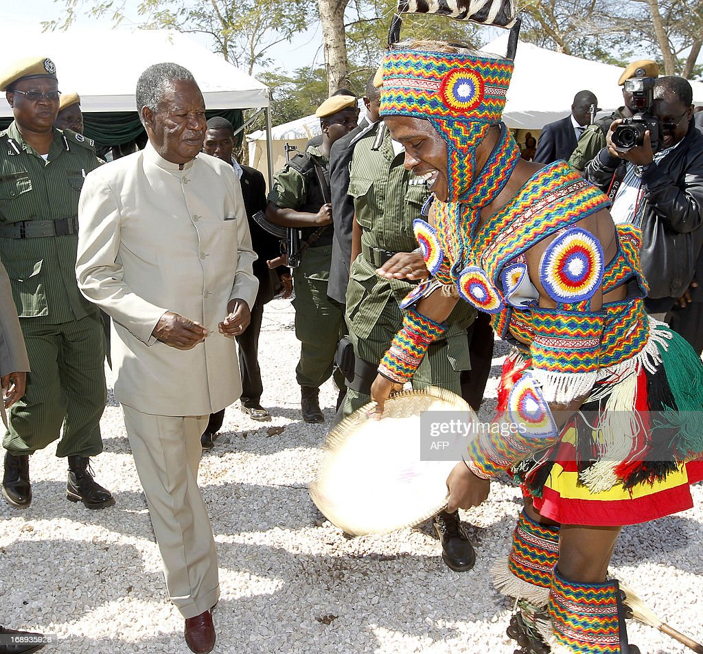 Zambia President <a gi-track='captionPersonalityLinkClicked' href=/galleries/search?phrase=Michael+Sata&family=editorial&specificpeople=1944545 ng-click='$event.stopPropagation()'>Michael Sata</a> joins a traditional dancer on May 17, 2013 during the commissioning of the construction of Palabana University in Chongwe, 60 kms east of Lusaka. Sata ordered police to arrest and expel University of Zambia students who protested in Lusaka against the removal of fuel and mealie meal subsidies. In a country with high unemployment, 60 percent of people living in poverty and the average income at $3.45 a day, any significant increase will cause economic and social shocks.