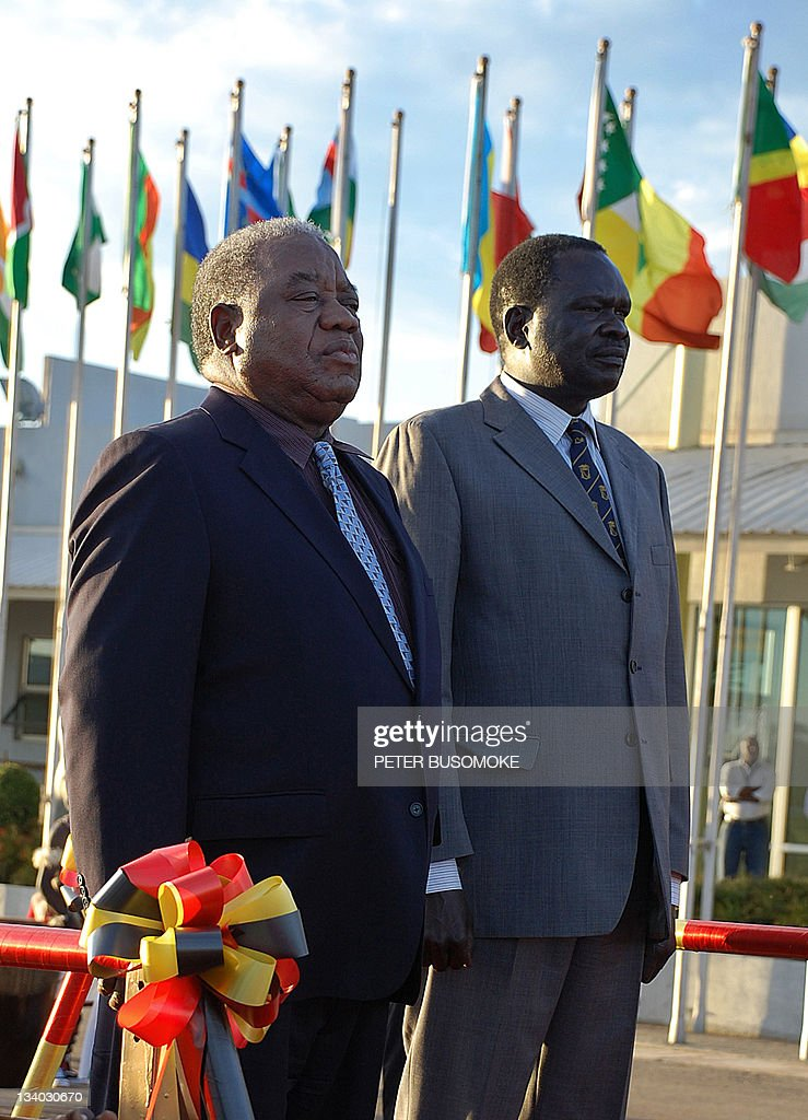 Zambia President Rupiah Banda [L] is received by Uganda Energy minister Hillary Onec at Entebbe airport in this October 21 2009 photo Banda is in...