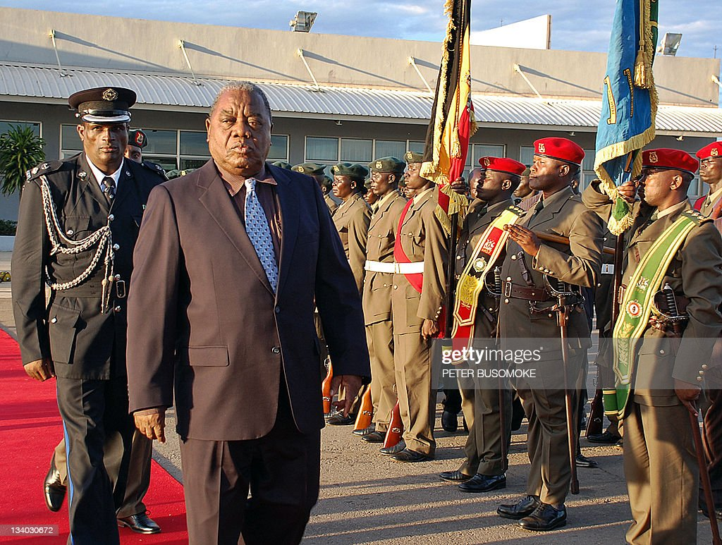 Zambia President Rupiah Banda of Zimbabwe inspects an honour guard by Uganda's military at Entebbe airport in this October 21 2009 photo Mugabe is in...