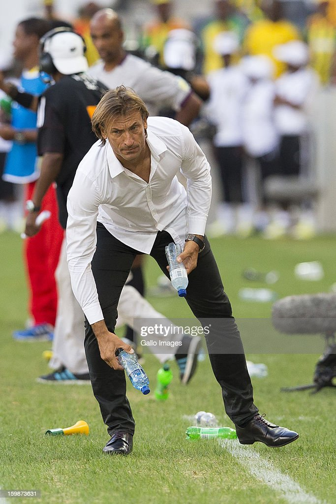 Zambian Manager Herve Renard picking up rubbish that was thrown by supporters onto field during the 2013 Orange African Cup of Nations match between Zambia and Ethiopia from Mbombela Stadium on January 21, 2012 in Nelspruit, South Africa